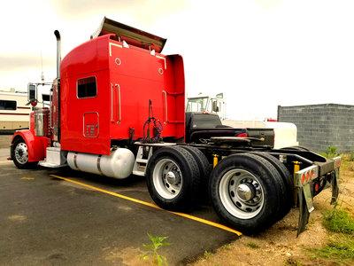 Image of Red Peterbilt Heavy Hauler before frame extension