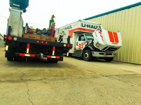 Mario Pena from US 281 Truck And Trailer Services LLC performing road service on a U-Hall truck
