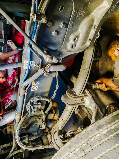 Our mechanic taking off leaf spring by removing u bolts on steering axle from a Kenworth US 281 Truck And Trailer Services LLC Edinburg