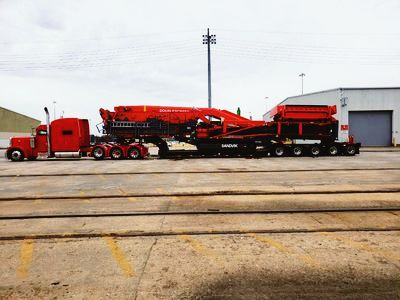 The red Peterbilt heavy hauler show truck's first load that we customized for Mr Anthony Mclean