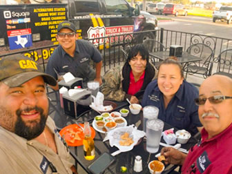 The US 281 Truck And Trailer Services LLC family dining at their Edinburg Workshop.